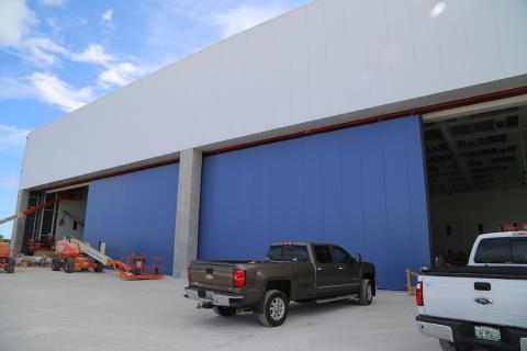 melbourne airport authority sectional hangar door provided by well bilt industries