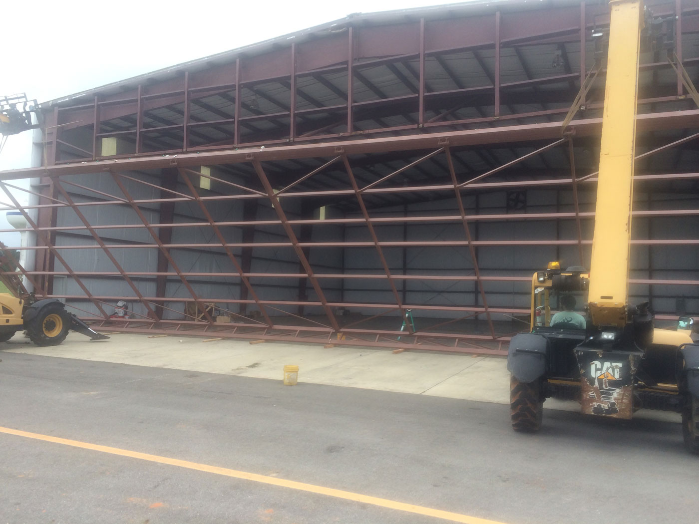 hydraulic hangar door install how to