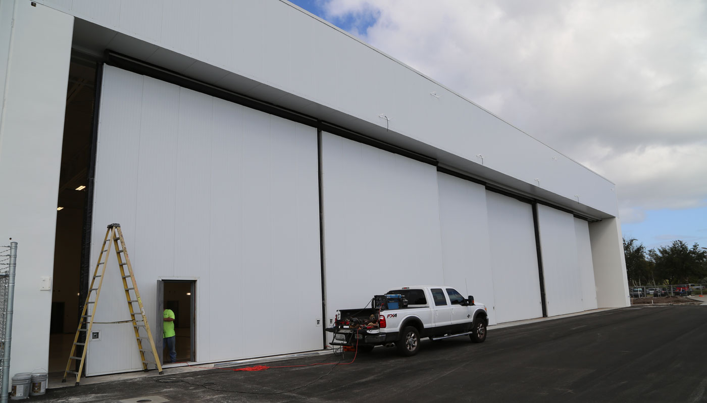 embraer delivery center melbourne florida six panel rolling door system