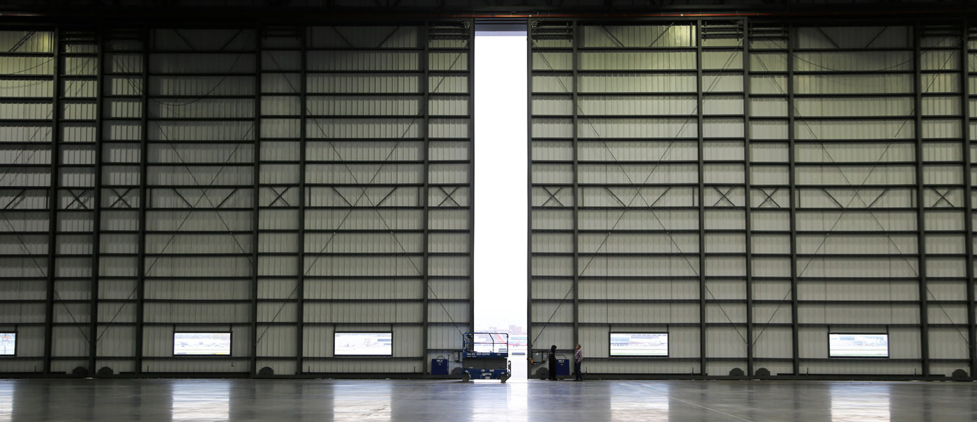 multiple section bottom rolling aircraft hangar doors by well bilt industries