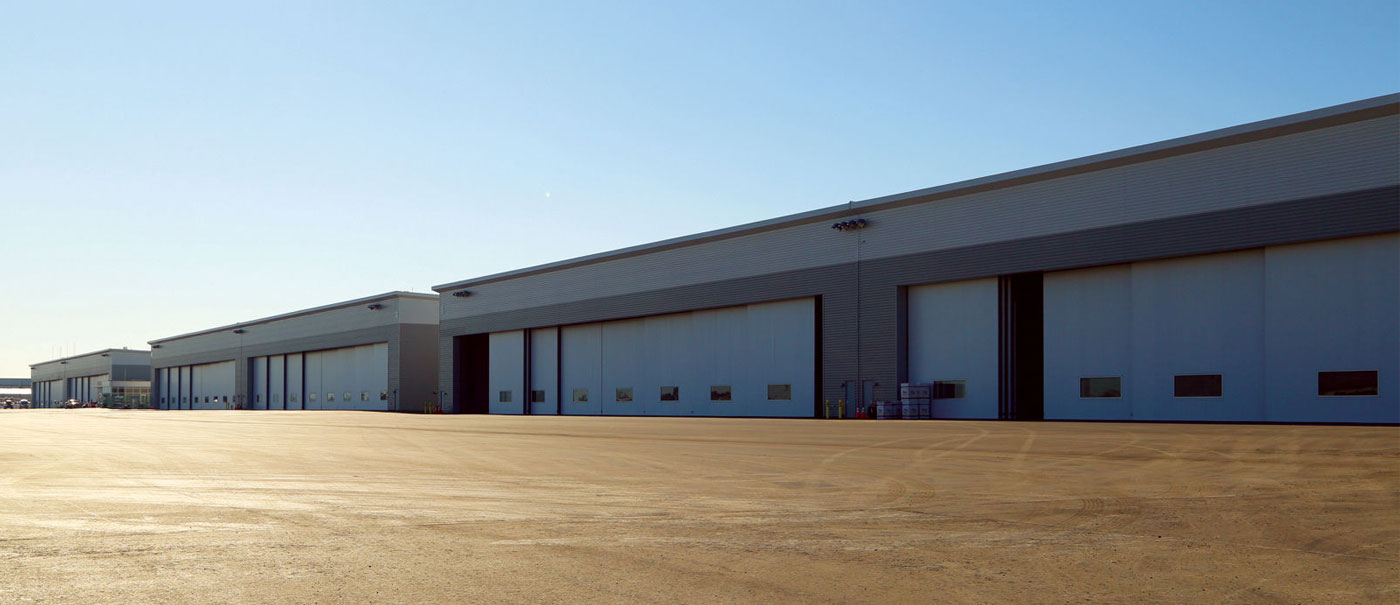 multi hangar complex fitted with bottom rolling hangar doors manufactured by well bilt industries