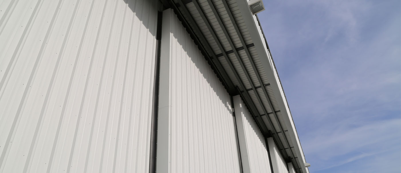 well bilt industries top rolling sectional hangar doors for smooth operation