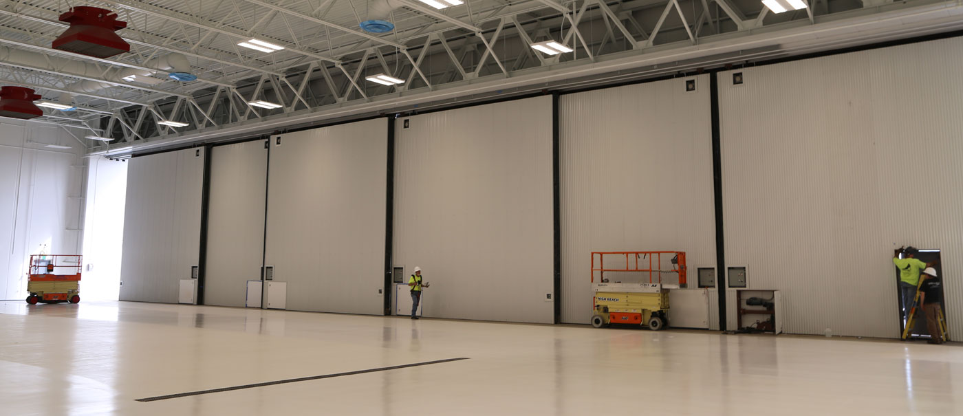 well bilt industries custom private aviation hangar door bottom rolling sectional doors