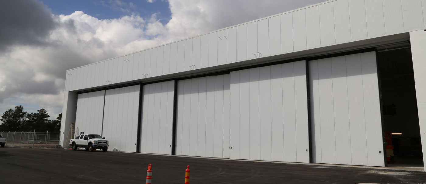 well bilt industries top rolling hangar door systems