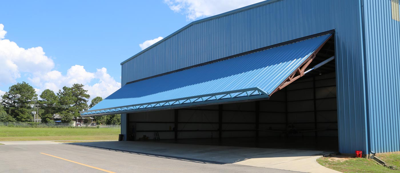 single panel hydraulic door systems patented side truss for extra strength and reliability