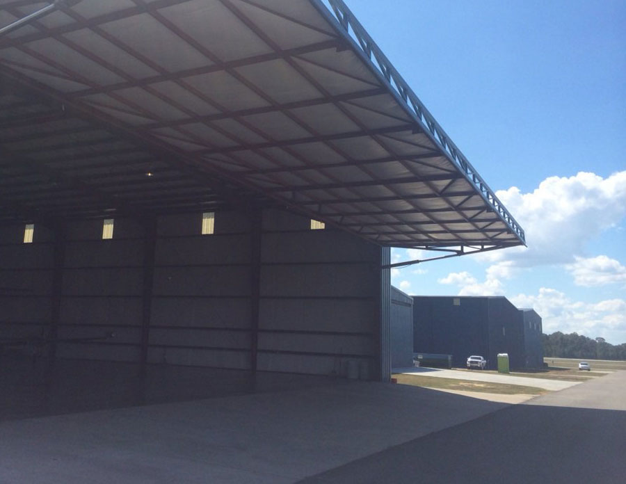 If youu0027re looking for a door thats easy to use and ads value to your building this is it! The Hydra-Eze Hydraulic Door System from WELL BILT Industries ... & Aircraft Hangar Doors   Bottom Rolling   Bi Fold   Single Panel ... pezcame.com