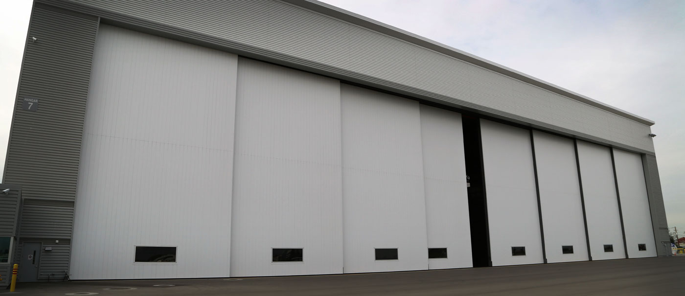 very large airplane hangar door bottom rolling panel door well bilt industries